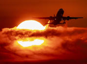 FILE - In this Sept. 19, 2019 file photo, an aircraft passes the rising sun during take off at the international airport in Frankfurt, Germany. World leaders breathed an audible sigh of relief that the United States under President Joe Biden is rejoining the global effort to curb climate change, a cause that his predecessor had shunned. (AP Photo/Michael Probst, File)