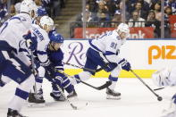 Tampa Bay Lightning center Steven Stamkos (91) handles the pack away from Toronto Maple Leafs center Alexander Kerfoot (15) during the second period of an NHL hockey game Thursday, Oct. 10, 2019, in Toronto. (Cole Burston/The Canadian Press via AP)