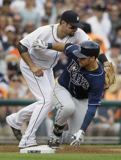 Tampa Bay Rays' Kevin Kiermaier, right, beats the tag of Detroit Tigers third baseman Nick Castellanos for a two-run triple during the sixth inning of a baseball game in Detroit, Saturday, July 5, 2014. (AP Photo/Carlos Osorio)