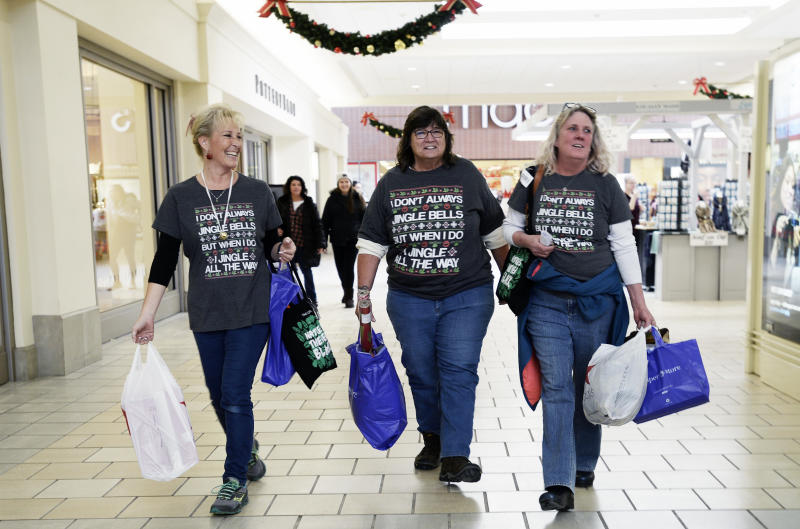 Michelle Bartlett of Westbrook, Karen Thompson of Naples and Ginger Throgmorton shop in the Maine Mall wearing matching shirts Friday, November 23, 2018. (Staff photo by Shawn Patrick Ouellette/Portland Portland Press Herald via Getty Images)