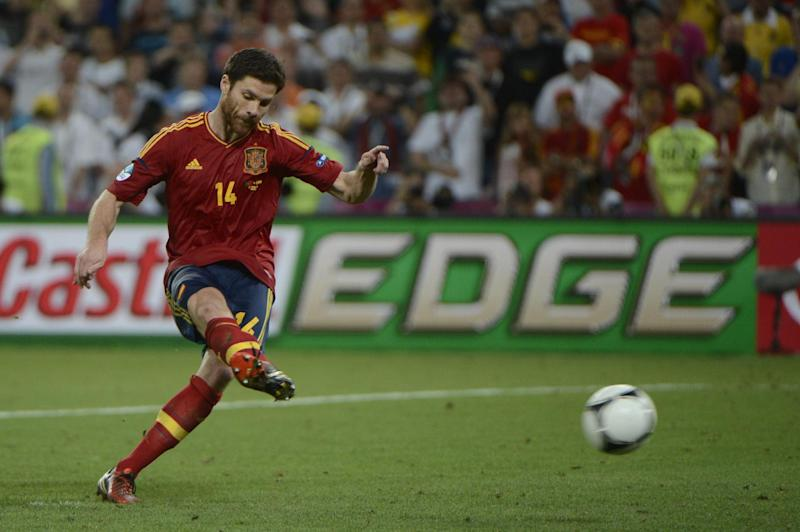 Spanish midfielder Xabi Alonso kicks a penalty shoot out during the Euro 2012 championships semi-final match against Portugal at the Donbass Arena in Donetsk on June 27, 2012