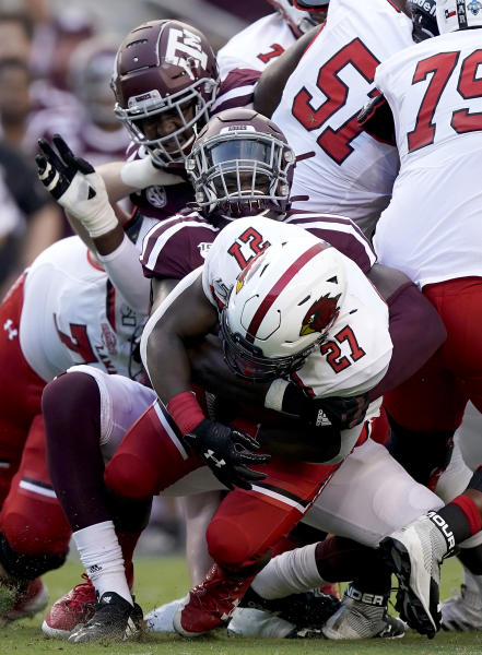 Texas A&M defensive lineman Micheal Clemons (91) tackles Lamar running back A.J. Walker (27) for a loss during the first half of an NCAA college football game, Saturday, Sept. 14, 2019, in College Station, Texas. (AP Photo/Sam Craft)