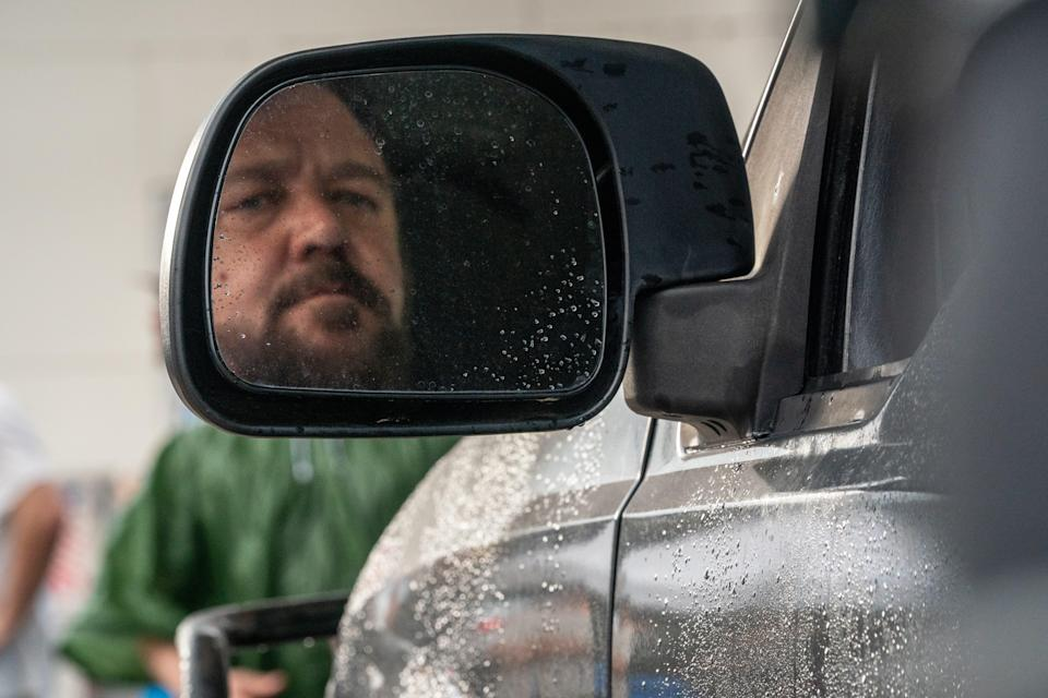 """The Man (Russell Crowe), using his truck as a destructive weapon, hunts down a woman who honked at him in """"Unhinged."""""""
