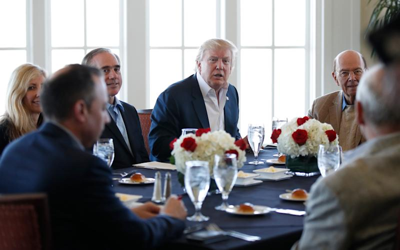 Donald Trump holds meeting at White House - Credit: AP
