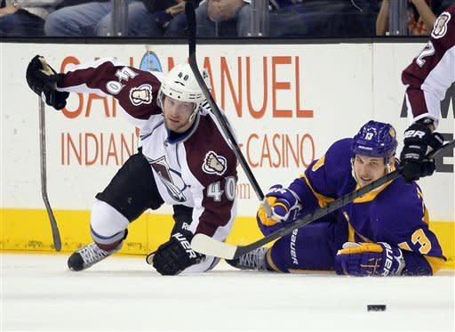 Colorado Avalanche center Mark Olver, left, and Los Angeles Kings left wing Kyle Clifford falls to the ice during the first period of their NHL hockey game, Saturday, Feb. 23, 2013, in Los Angeles. The Lakers won 111-107. (AP Photo/Mark J. Terrill)