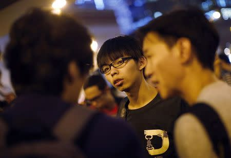 Joshua Wong, leader of the student movement, talks to reporters outside the government headquarters office in Hong Kong October 9, 2014.   REUTERS/Carlos Barria