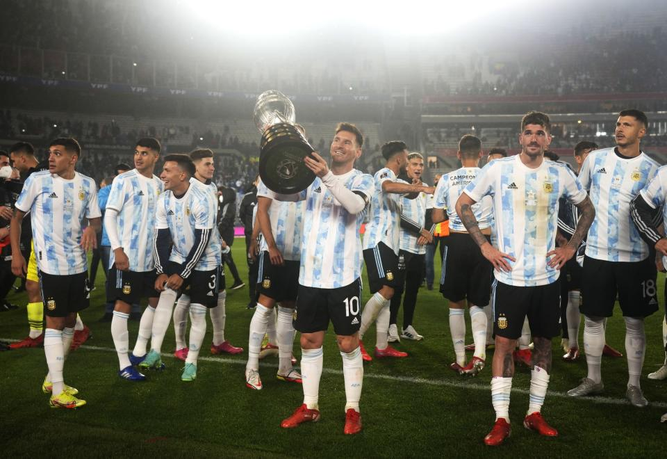 Argentina's Lionel Messi, center, holds the Copa America trophy at the end a qualifying soccer match for the FIFA World Cup Qatar 2022, against Bolivia in Buenos Aires, Argentina, Thursday, Sept. 9, 2021. (AP Photo/Natacha Pisarenko, Pool)