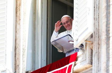 Pope Francis waves as he leads Sunday Angelus prayer in Saint Peter's square at the Vatican