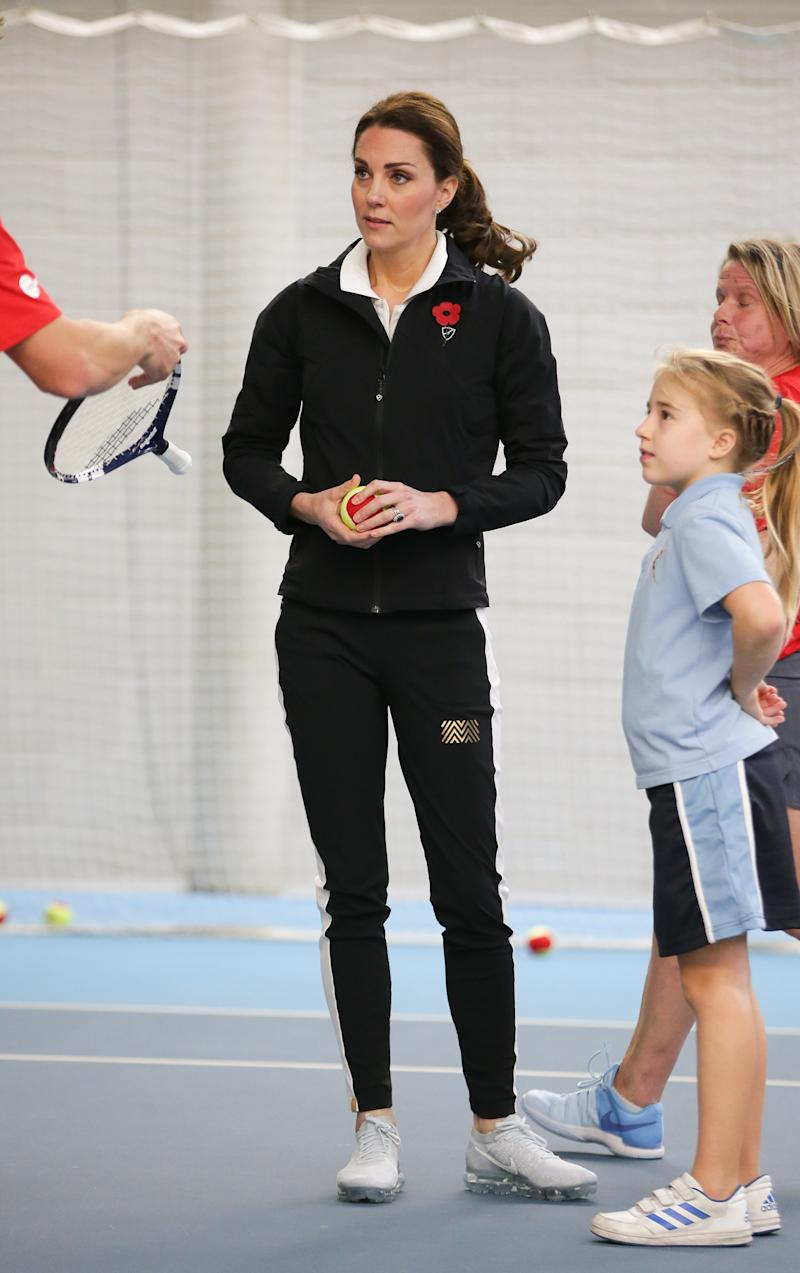 The Duchess of Cambridge takes part in a Tennis for Kids session during a visit at the Lawn Tennis Association at the National Tennis Centre on Oct. 31, 2017. (WPA Pool via Getty Images)