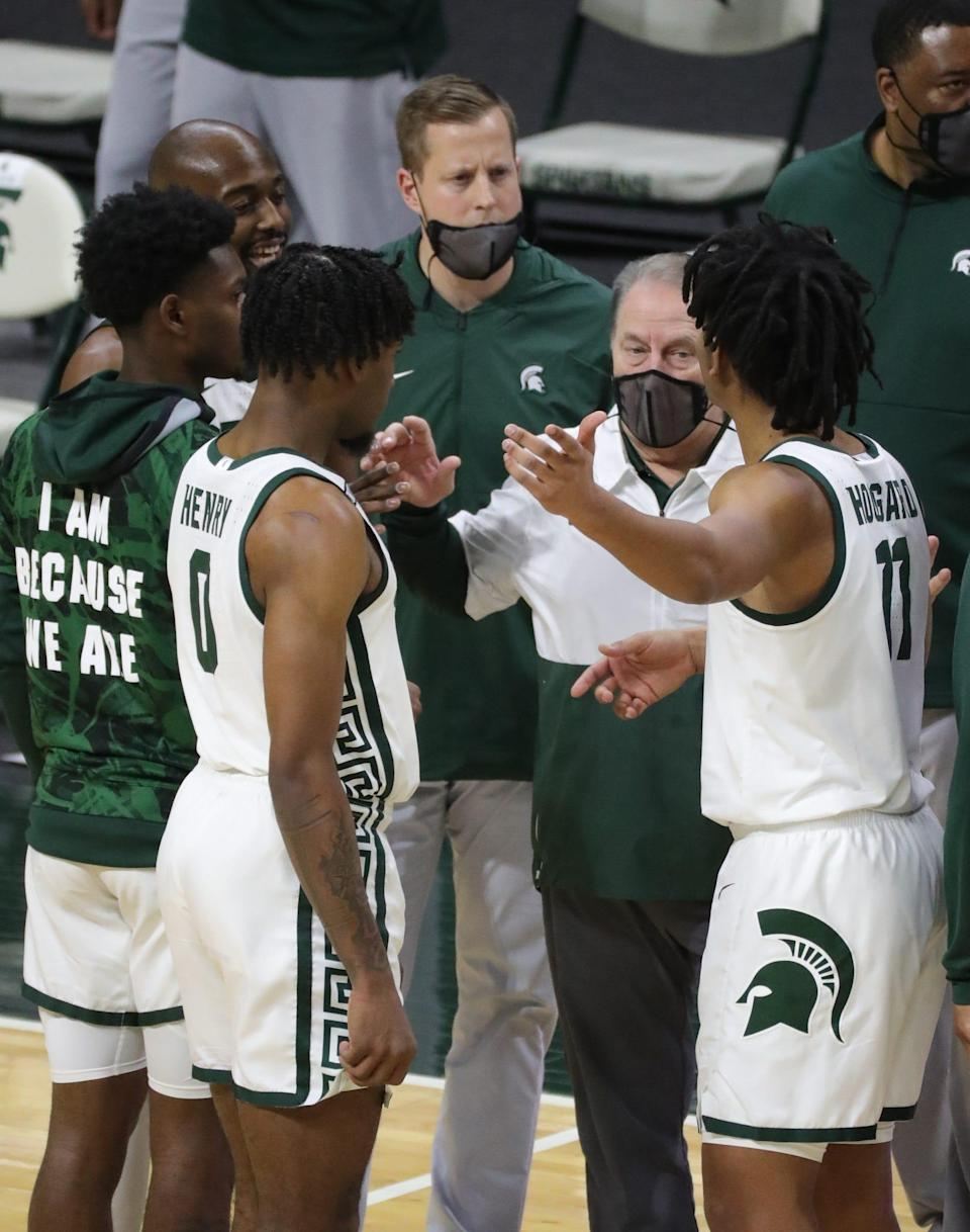Michigan State Spartans head coach Tom Izzo talks with his players Sunday, March 7, 2021, at the Breslin Center in East Lansing.