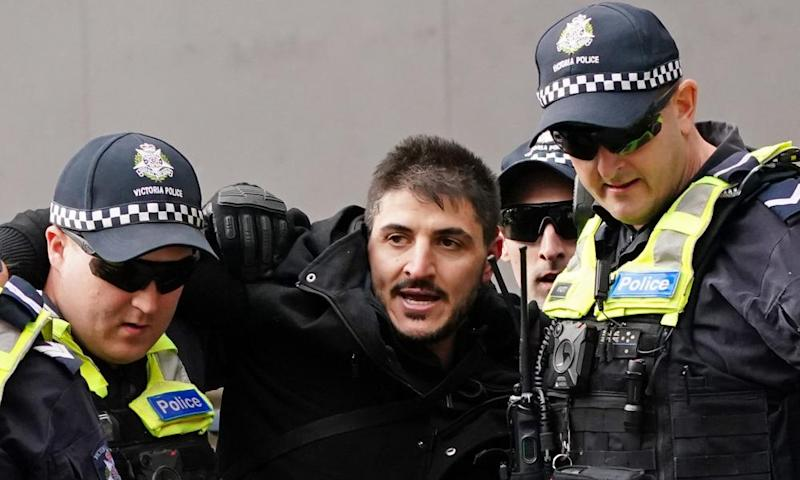 Fanos Panayides is detained by police at an anti-lockdown protest outside Parliament House in Melbourne on 10 May.