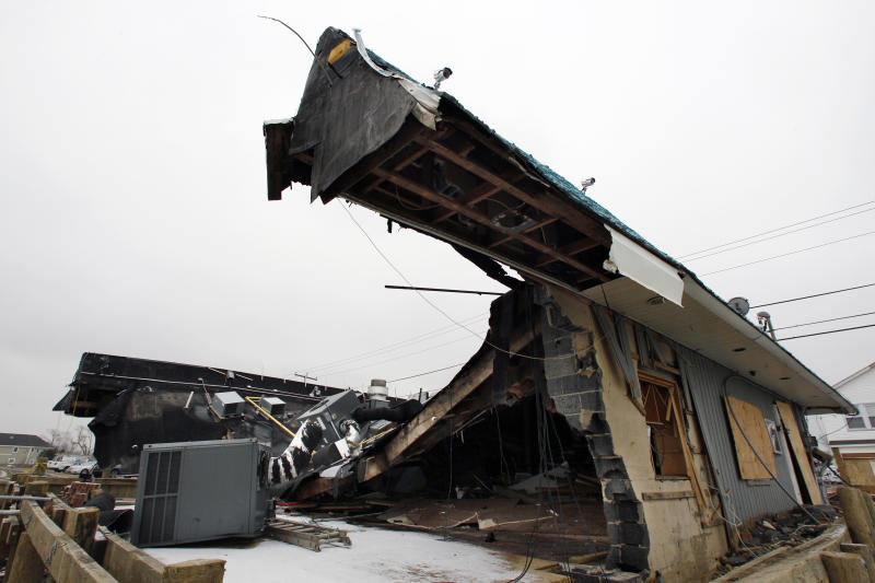 "Heavily damaged by Superstrom Sandy, Jakeabob's Bay restaurant is seen Tuesday, Feb. 5, 2013, in Union Beach, N.J. New Jersey Gov. Christie told a gathering in Union Beach Tuesday that the National Flood Insurance Program's handling of claims in New Jersey ""has stunk,"" complaining that the program has been far too slow to resolve claims from Superstorm Sandy, with 70 percent of cases unresolved three months after the disaster. (AP Photo/Mel Evans)"