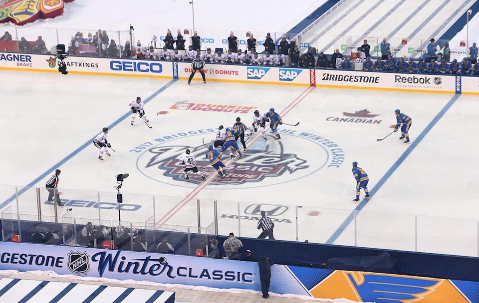 <p>ST LOUIS, MO – JANUARY 02: Jonathan Toews #19 of the Chicago Blackhawks and Jori Lehtera #12 of the St. Louis Blues take the opeing faceo-off in the first period of the 2017 Bridgestone NHL Winter Classic at Busch Stadium on January 2, 2017 in St Louis, Missouri. (Photo by Jared Silber/NHLI via Getty Images) </p>