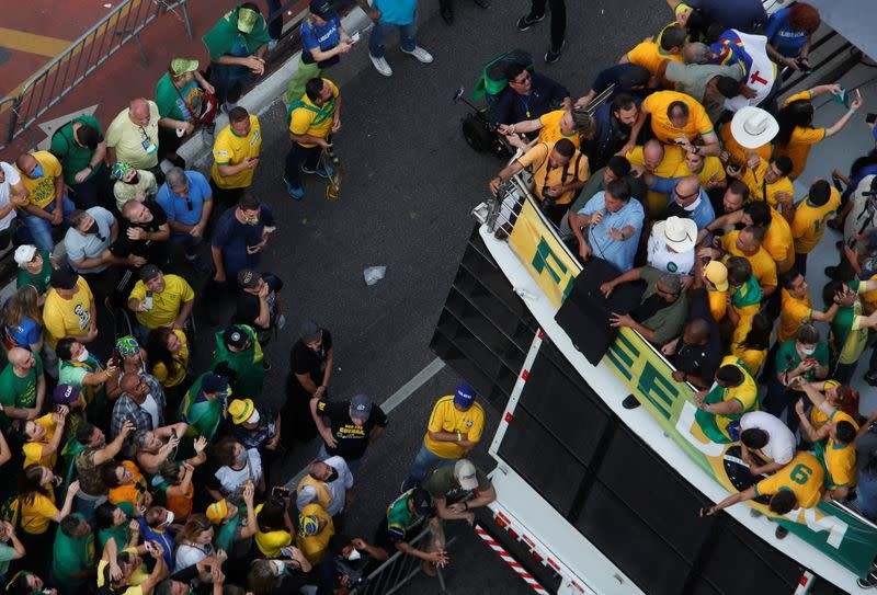 Brazilian President Jair Bolsonaro speaks to his supporters as they gather to back the far-right leader in his dispute with the Supreme Court, in Sao Paulo
