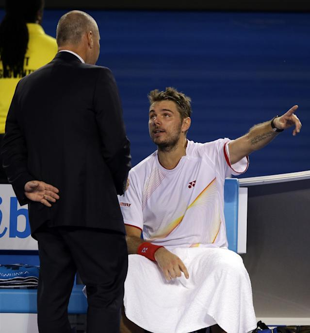 Stanislas Wawrinka of Switzerland, right, talks with tournament referee Wayne McKewen as Rafael Nadal of Spain takes an injury time out during the men's singles final at the Australian Open tennis championship in Melbourne, Australia, Sunday, Jan. 26, 2014.(AP Photo/Aaron Favila)