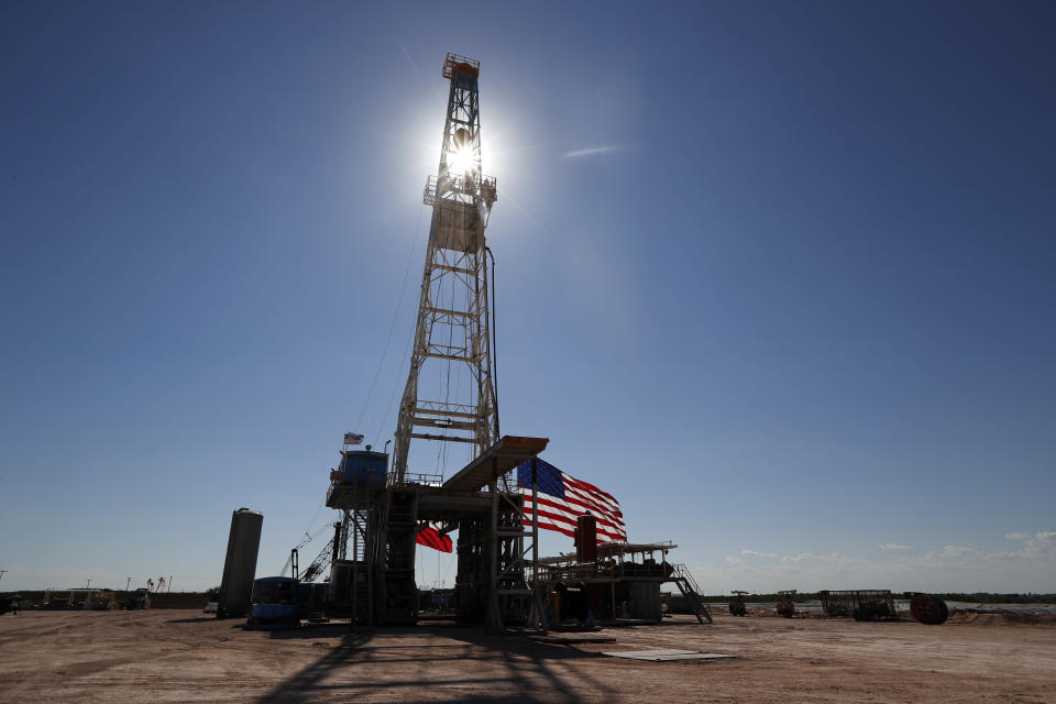 An American flag flies near an oil rig near the site where President Donald Trump delivered remarks about American energy production during a visit to the Double Eagle Energy Oil Rig, Wednesday, July 29, 2020, in Midland, Texas. (AP Photo/Tony Gutierrez)