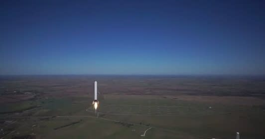 SpaceX's Grasshopper rocket prototype, designed to be reusable instead of burning up in the atmosphere, made a record-setting vertical takeoff and landing on October 7. This video, released by SpaceX on October 12, shows the Grasshopper in action, as seen from a single camera hexacopter which provides a unique view on the test flight as the rocket reaches a record 744 meters. Credit: SpaceX