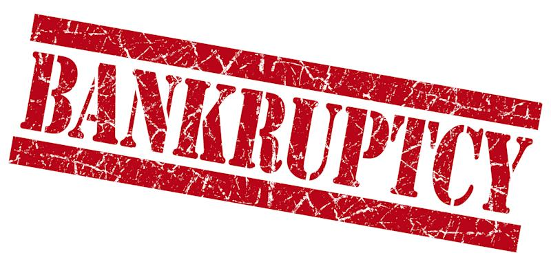 """The word """"bankruptcy"""" is stamped in red in large letters."""