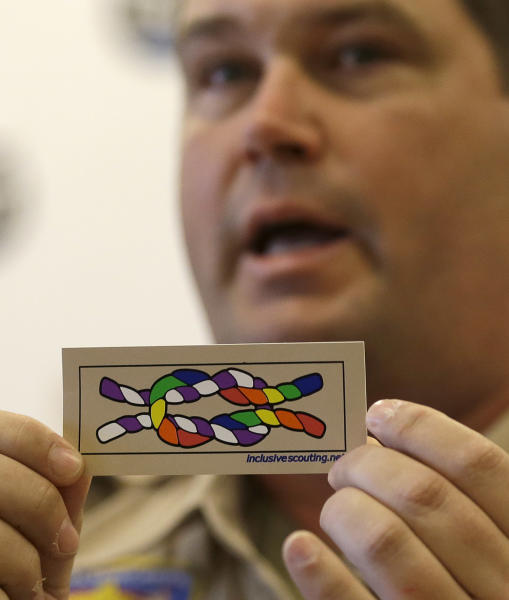 Former scout maser Mark Noel, of Hanover, NH, holds up a new merit badge of inclusion during a press conference at the Equal Scouting Summit being held near where the Boy Scouts of America are holding their annual meeting Wednesday, May 22, 2013, in Grapevine, Texas. Delegates to the Boys Scouts of America meeting are expected to address a proposal to allow gay scouts into the organization. (AP Photo/LM Otero)