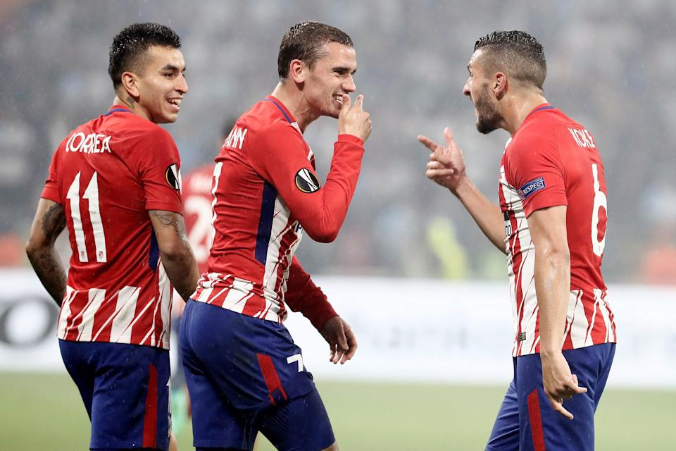 Antoine Griezmann celebrates one of his two goals for Atletico Madrid in the Europa League final. (EFE)