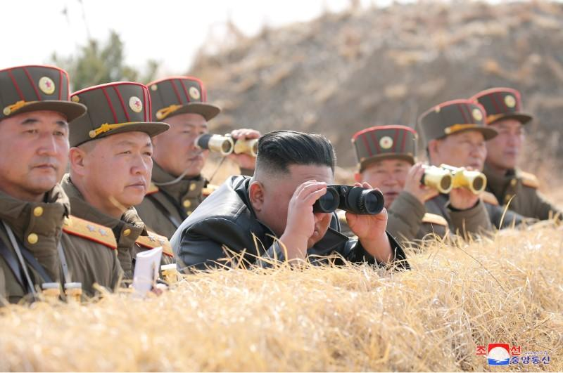 North Korean leader Kim Jong Un guides artillery fire competition in this image released by North Korea's Korean Central News Agency