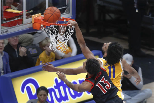 The ball bounces out of the rim as Louisville's David Johnson (13) misses a dunk next to Pittsburgh's Justin Champagnie during the second half of an NCAA college basketball game Tuesday, Jan. 14, 2020, in Pittsburgh. (AP Photo/Keith Srakocic)