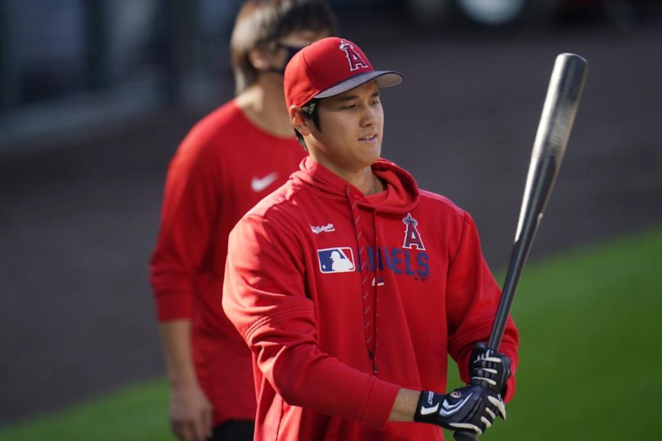 Angels designated hitter Shohei Ohtani warms up before a game.