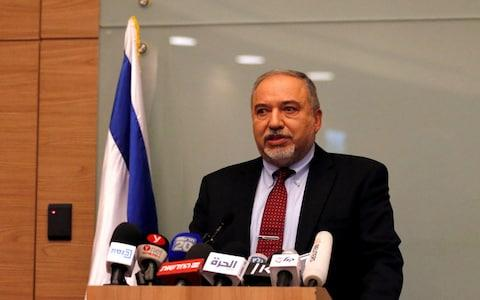 The resignation of Avigdor Lieberman, one of Mr Netanyahu's coalition partners, rocks the Israeli government and could trigger fresh elections in the Jewish state.  - Credit: REUTERS/Ammar Awad