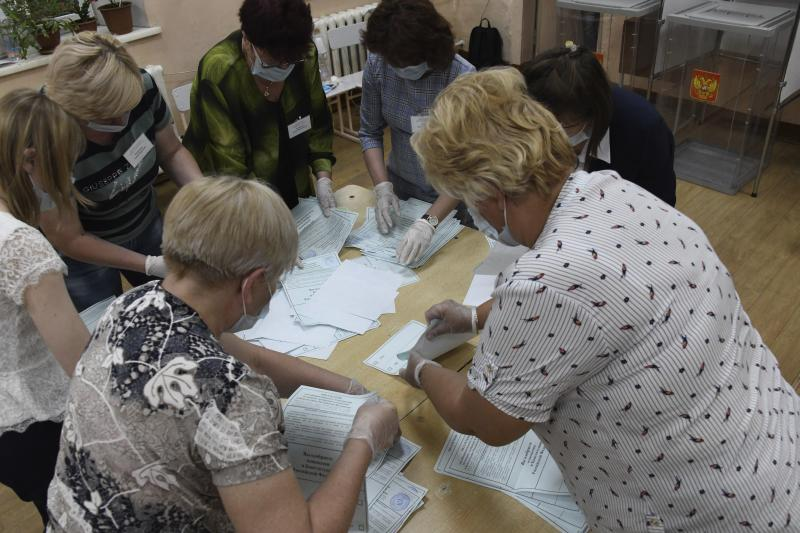 Members of an election commission, wearing face masks and gloves to protect against coronavirus count ballots after voting at a polling station in eastern Siberian city of Chita, Russia, Wednesday, July 1, 2020. Russia's vote on constitutional amendments that could allow President Vladimir Putin to extend his rule until 2036 entered its final day Wednesday amid widespread reports of pressure on voters and other irregularities. (AP Photo)