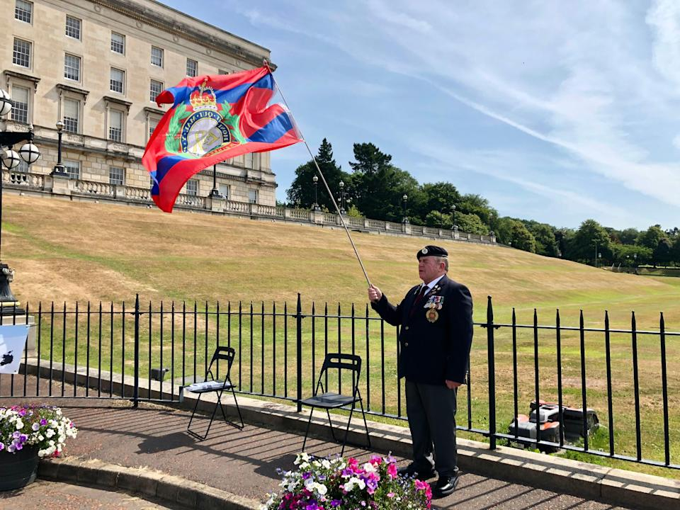 Robert Donaldson from Enniskillen, who served with the police and Army during the Troubles, joins the protest at Stormont (David Young/PA)
