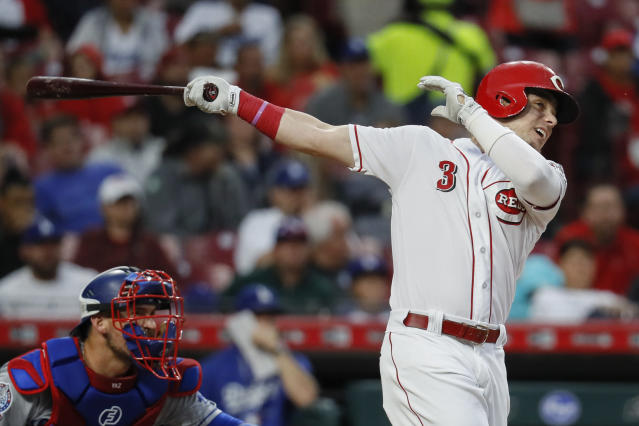 Cincinnati Reds' Scooter Gennett hits an RBI single off Los Angeles Dodgers starting pitcher Alex Wood in the first inning of a baseball game, Monday, Sept. 10, 2018, in Cincinnati. (AP Photo/John Minchillo)