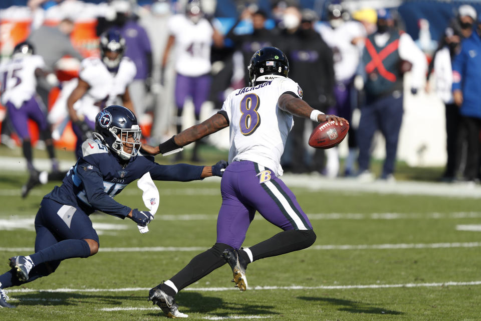 Lamar Jackson's amazing 48-yard touchdown run tied the game against the Titans and jolted the Ravens to life. (Photo by Wesley Hitt/Getty Images)