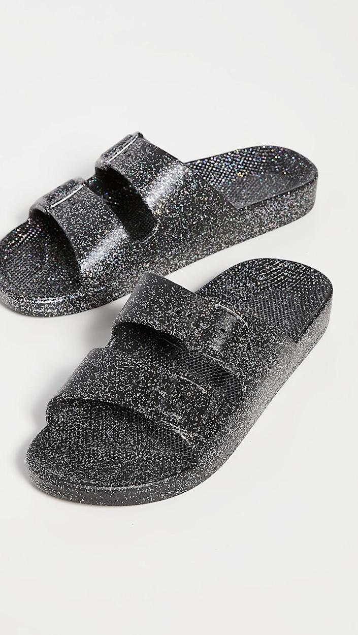 <p>They can slip on these <span>Freedom Moses Moses Slide Sandals</span> ($45).</p>