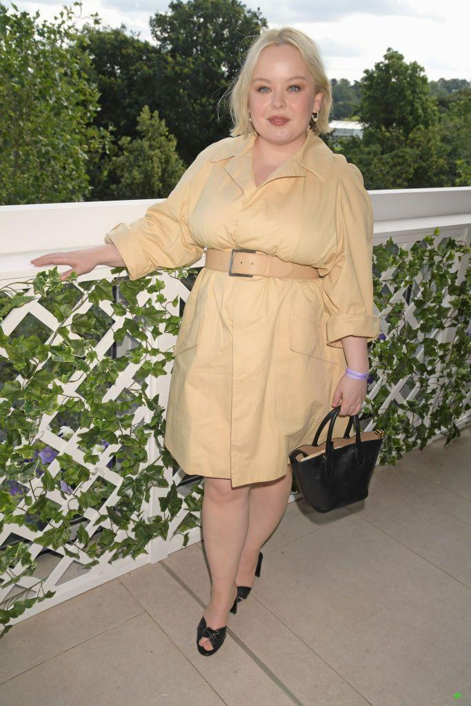 <p>The Irish star looked sleek in a butter-hued coat dress.</p>