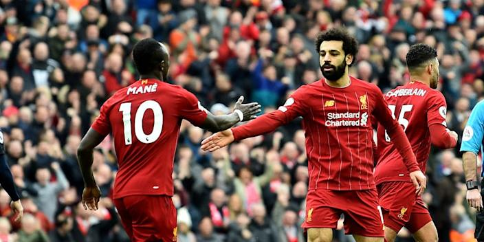 Mohamed Salah of Liverpool celebrates scoring Liverpool's second goal with Sadio Mane during the Premier League match between Liverpool FC and AFC Bournemouth at Anfield on March 07, 2020 in Liverpool, United Kingdom.