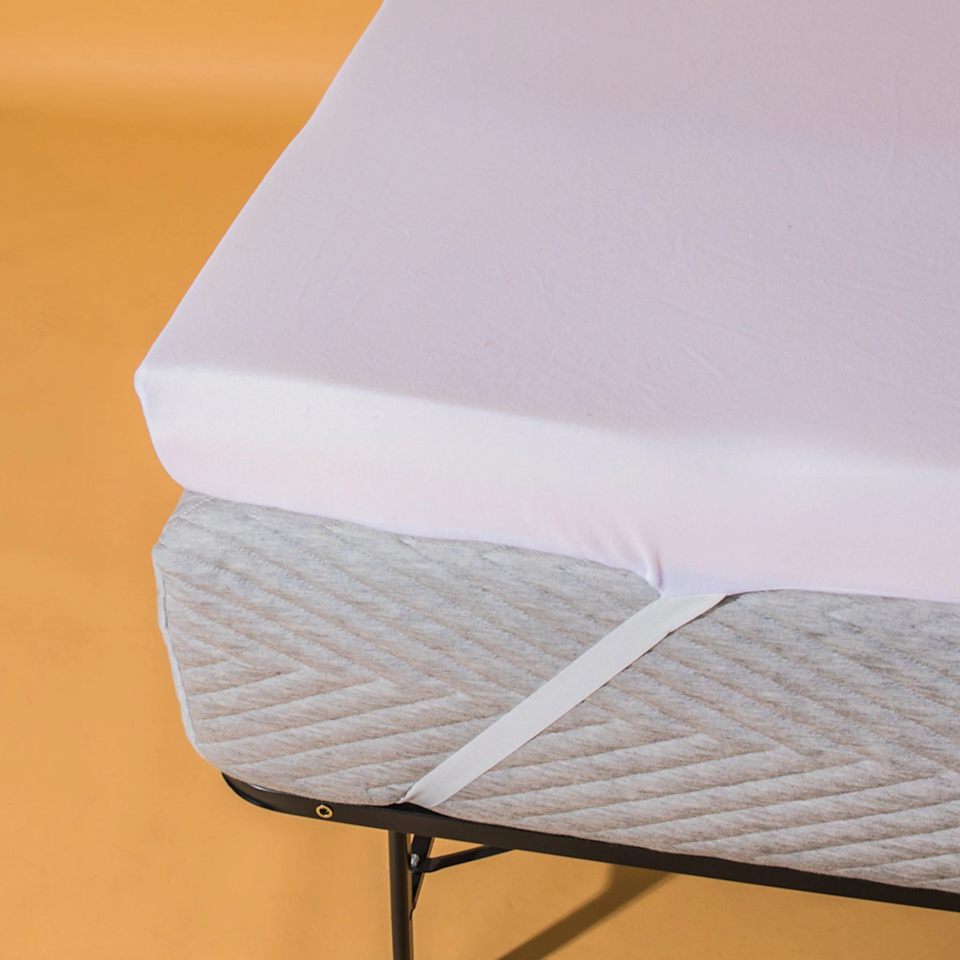 """<h3>Coop Home Goods Flip Mattress Topper</h3><br><strong>Best For:</strong> <strong>Firm OR Soft Sleep</strong><br>This 4-inch memory foam topper packs reversible powers that offer the option of both soft <em>and</em> firm support — plus, it also comes bundled with a 100% waterproof mattress protector, 100-night sleep trial, and five-year limited warranty. <br><br><strong>The Hype: 4.9 out of 5 stars</strong><br><br><strong>Sleepers Say:</strong> """"We recently decided that our mattress was too soft and had been mattress shopping. After getting a price quote way out of our budget, we decided to go back to the drawing board to find something more affordable for the time being. I loved the fact that you can flip this topper to be softer or firmer. So far, we have only used the firm side, but it made our bed exact support that we have been looking for without feeling like we were sleeping on the concrete floor! We really liked the cover that lets you strap the topper to your bed, it really keeps it in place instead of having it slide all over the place while you're sleeping. It did add some height to my mattress, which I personally love, and BONUS my Solstice sheets still fit great even with the added height. The packaging was awesome, it came vacuum sealed and I would definitely recommend this to anyone that's looking for more support with their mattress or, to make their mattress a little softer."""" <em>– Audrey, Coop Home Goods Reviewer</em><br><br><em>Shop </em><strong><a href=""""https://coophomegoods.com/products/flip-mattress-topper"""" rel=""""nofollow noopener"""" target=""""_blank"""" data-ylk=""""slk:Coop Home Goods"""" class=""""link rapid-noclick-resp""""><em>Coop Home Goods</em></a></strong><br><br><strong>Coop Home Goods</strong> Flip Mattress Topper, $, available at <a href=""""https://go.skimresources.com/?id=30283X879131&url=https%3A%2F%2Fcoophomegoods.com%2Fproducts%2Fflip-mattress-topper"""" rel=""""nofollow noopener"""" target=""""_blank"""" data-ylk=""""slk:Coop Home Goods"""" class=""""link rapid-noclick-r"""