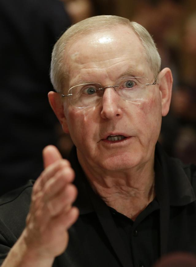 New York Giants head coach Tom Coughlin talks with reporters during the NFC Head Coaches Breakfast at the NFL football meetings in Orlando, Fla., Wednesday, March 26, 2014. (AP Photo/John Raoux)