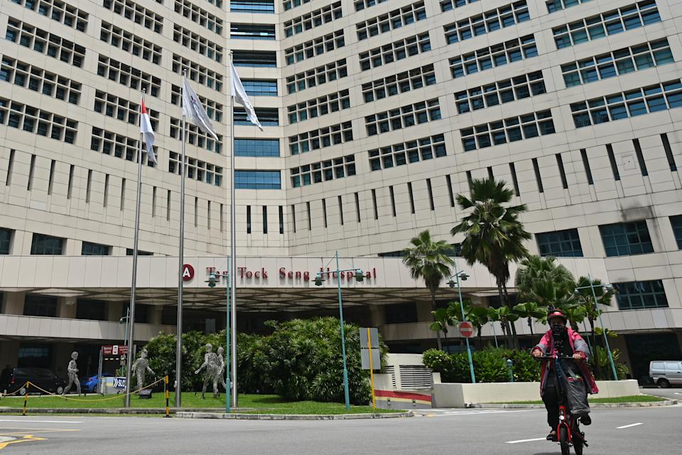 The exterior of Tan Tock Seng Hospital is pictured in Singapore on April 30, 2021, as authorities sought to contain the spread of the Covid-19 coronavirus after a cluster of cases were detected at the facility. (Photo by ROSLAN RAHMAN / AFP) (Photo by ROSLAN RAHMAN/AFP via Getty Images)