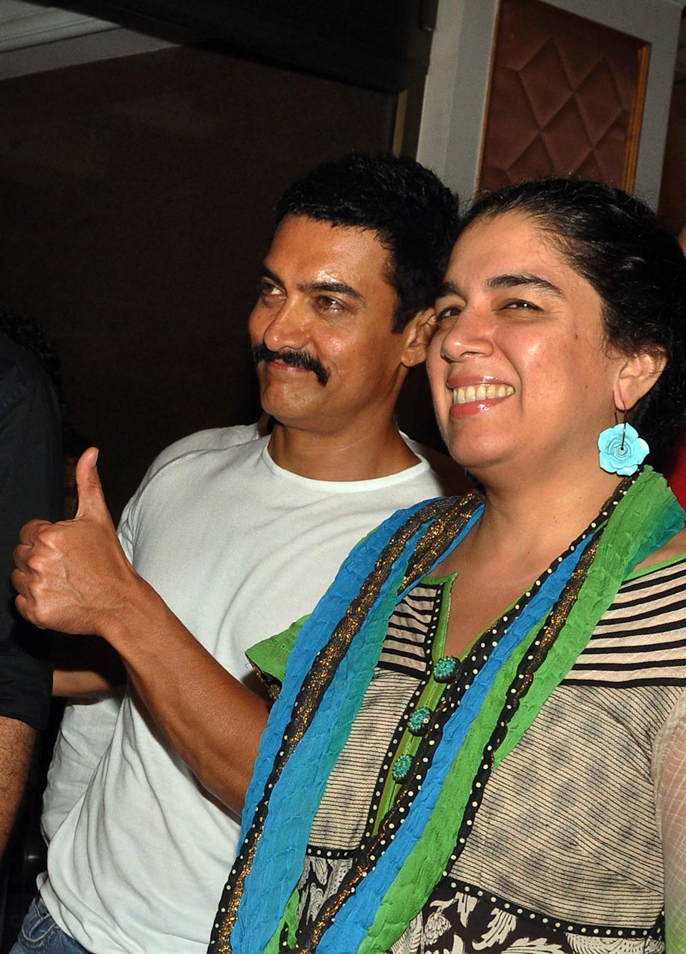 Indian Bollywood film actor Aamir Khan (L) and his first and former wife Reena Dutta attend the tenth anniversary celebration party of Hindi film 'Lagaan' in Mumbai on June 15, 2011.  PHOTO/STR (Photo credit should read STR/AFP via Getty Images)