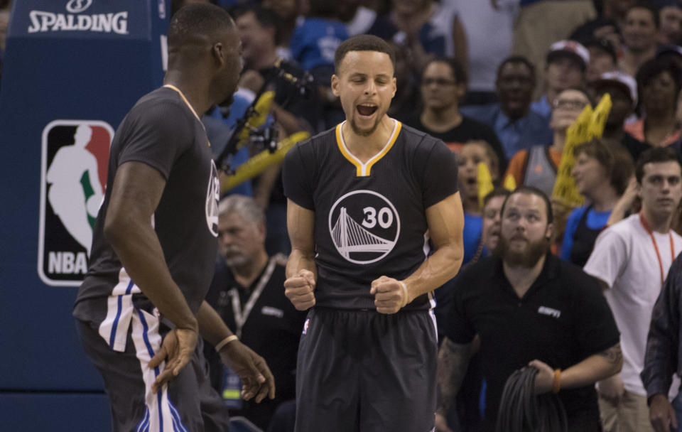 OKLAHOMA CITY, OK - FEBRUARY 27: Stephen Curry #30 of the Golden State Warriors celebrates after tying the game against the Oklahoma City Thunder during the fourth period of a NBA game at the Chesapeake Energy Arena on February 27, 2016 in Oklahoma City, Oklahoma. The Warriors won 121-118 in overtime. NOTE TO USER: User expressly acknowledges and agrees that, by downloading and or using this photograph, User is consenting to the terms and conditions of the Getty Images License Agreement. (Photo by J Pat Carter/Getty Images)