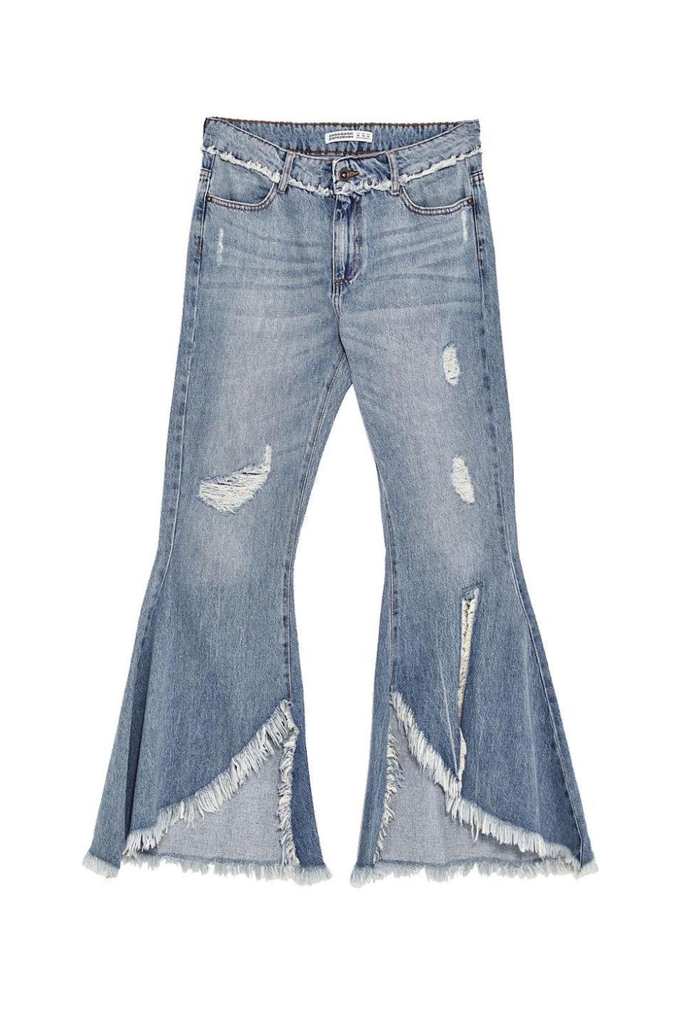 """<p>A slightly less extra version of the jeans in the main pic. </p><p><strong>BUY IT:</strong> Zara, $50; <a href=""""https://www.zara.com/us/en/woman/jeans/view-all/mid-rise-frayed-jeans-c719019p4661614.html"""" rel=""""nofollow noopener"""" target=""""_blank"""" data-ylk=""""slk:zara.com"""" class=""""link rapid-noclick-resp"""">zara.com</a>.</p>"""