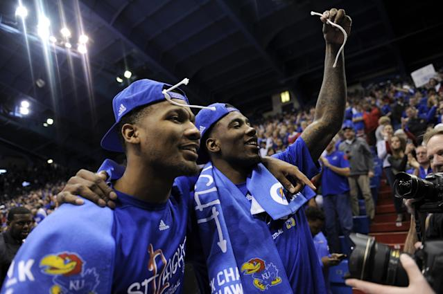 LAWRENCE, KS - FEBRUARY 27: Wayne Selden Jr. #1 and Jamari Traylor #31 of the Kansas Jayhawks celebrate after defeating the Texas Tech Red Raiders 67-58 to clinch its 12th straight Big 12 Conference Championship at Allen Fieldhouse on February 27, 2016 in Lawrence, Kansas. (Photo by Ed Zurga/Getty Images)
