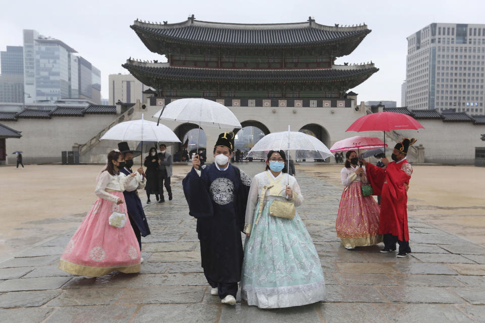 People wearing face masks to help protect against the spread of the coronavirus visit the Gyeongbok Palace in Seoul, South Korea, Sunday, Nov. 1, 2020. (AP Photo/Ahn Young-joon)