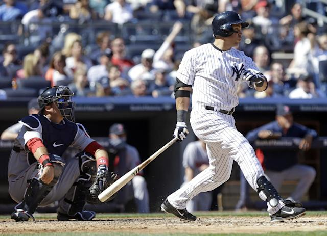 New York Yankees' Carlos Beltran follows through with a double during the sixth inning of a baseball game as Boston Red Sox catcher A.J. Pierzynski watches the ball hit by Beltran, Saturday, April 12, 2014, in New York. (AP Photo/Frank Franklin II)