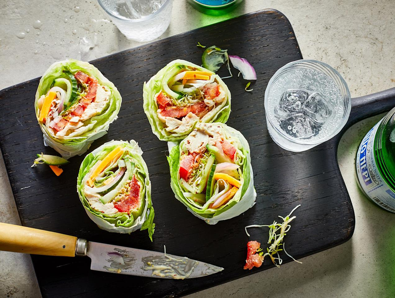 "<p>This fresh, crunchy wrap sandwich is brimming with vegetables, yet still delivers a satisfying amount of protein thanks to the chicken and cheese. Crisp iceberg lettuce is what keeps this wrap sandwich ultra low in carbs (just 4 grams per serving). The hardest part of this 10-minute recipe is rolling the sandwich, but our parchment paper trick makes it infinitely simpler.</p> <p> <a href=""https://www.cookinglight.com/recipes/low-carb-chicken-and-cheddar-lettuce-wraps"">View Recipe: Low-Carb Chicken and Cheddar Lettuce Wraps</a></p>"