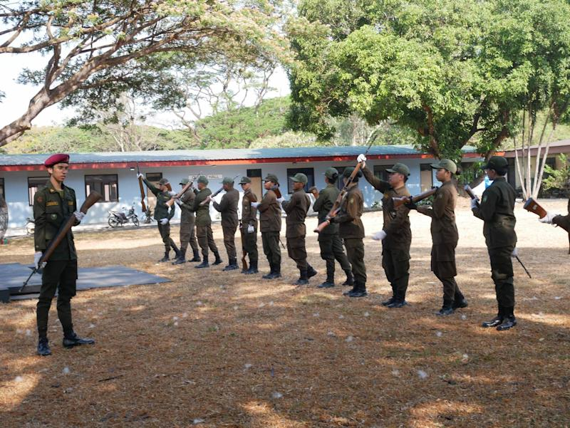 ROTC students learn rifle drills at UP Diliman. Photo: Rachel Malaguit