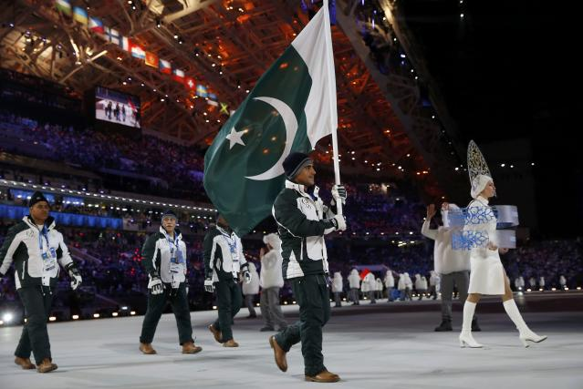 Pakistan's flag-bearer Muhammad Karim leads his country's contingent during the athletes' parade at the opening ceremony of the 2014 Sochi Winter Olympics, February 7, 2014. REUTERS/Jim Young (RUSSIA - Tags: OLYMPICS SPORT)