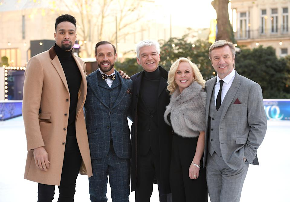 LONDON, ENGLAND - DECEMBER 19:  (L-R) Ashley Banjo, Jason Gardiner, Phillip Schofield, Jayne Torvill and Christopher Dean attend the Dancing On Ice 2018 photocall held at Natural History Museum Ice Rink on December 19, 2017 in London, England.  (Photo by Karwai Tang/WireImage)