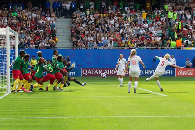 Steph Houghton (5) converts an indirect free kick during England's round of 16 win over Cameroon in Valenciennes. (Getty)