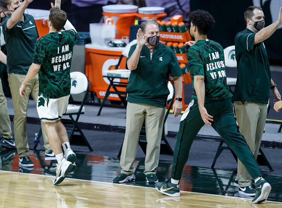 Drew Denisco, right, and Michigan State coach Tom Izzo high-five players before the Nebraska game at Breslin Center in East Lansing, Saturday, Feb. 6, 2021. Eastern Michigan on Tuesday hired Denisco, who spent six seasons as Izzo's video coordinator.
